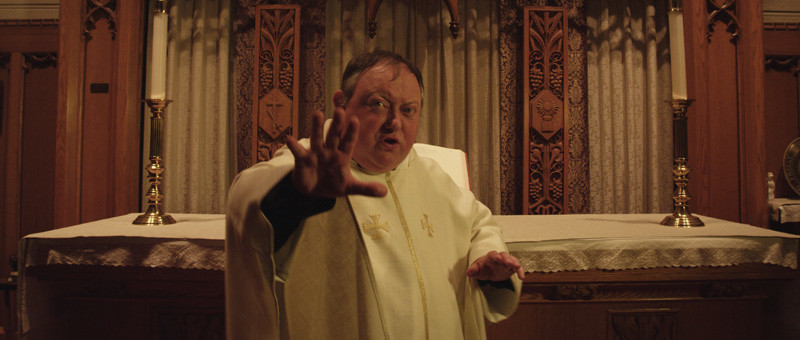 Father Clarke (LAURENCE R HARVEY)