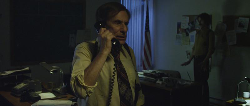 police chief on phone (JERRY WASSERMAN)